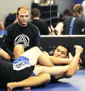 Monica Maschak - mmaschak@shawmedia.com MMA fighter Joey Diehl (left) watches as two others practice sparring at the Team Curran Martial Arts in Crystal Lake on Tuesday, November 20, 2012.  In December, Diehl will be competing in the Bellator, a MMA tournament, that airs on MTV2.
