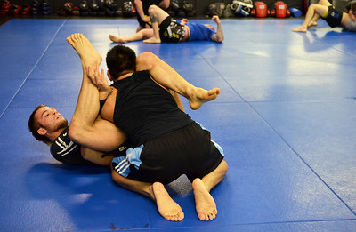 Monica Maschak - mmaschak@shawmedia.com MMA fighter Joey Diehl (left) spars with a partner during a practice at Team Curran Martial Arts in Crystal Lake on Tuesday, November 20, 2012.  Diehl is on the card for the Bellator, a MMA tournament, in December that airs on MTV2.