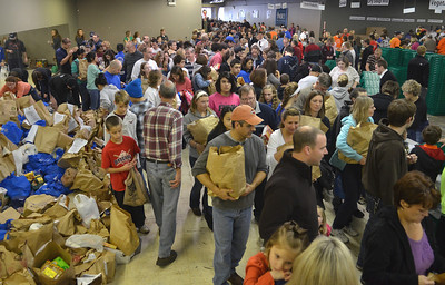 Monica Maschak - mmaschak@shawmedia.com More than 1000 residents of Crystal Lake and surrounding communities volunteer their time to sorting non-perishable food items at the Community Harvest in the Crystal Lake Plaza on Thanksgiving day. Donations, both food and monetary, are used to benefit clients of the Crystal Lake Food Pantry as well as the Jaycees' Share-A-Christmas program.