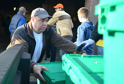 Monica Maschak - mmaschak@shawmedia.com Wayne Noska, of Island Lake, loads filled bins onto the bed of a truck during the Community Harvest on Thanksgiving.  The filled bins were then transported to the Crystal Lake Food Pantry where they will be distributed to local families in need during the winter months.