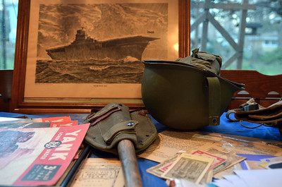 Monica Maschak - mmaschak@shawmedia.com World War II items cover a table in Barbara Klapperich's kitchen.  She has a collection of war memorablia from her father and her uncle, which she takes to local schools to present to students and teach them what WWII days were like.