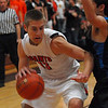 St. Charles East's Ben Skoog makes his way towards the basket during their Ron Johnson tournament game against town rivals St. Charles North Saturday Nov. 24, 2012. St. Charles East defeated St. Charles North 61/42. Staff photo by Erica Benson