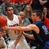 St. Charles East's AJ Washington passes the ball during their Ron Johnson tournament game against town rivals St. Charles North Saturday Nov. 24, 2012. St. Charles East defeated St. Charles North 61/42. Staff photo by Erica Benson