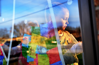 Monica Maschak - mmaschak@shawmedia.com Kindergartener Rian Fossum decorates an interior window of Paulee's Pizzeria with a Christmas tree design in Wonder Lake on Tuesday, November 27, 2012.  Fossum is part of the Muse Art Club for K-5th grade at Harrison Elementary School.  The club was asked to decorate the pizzeria and the Chamber of Commerce in preparation for Winter Wonder Walk on Saturaday, December 1, 2012.