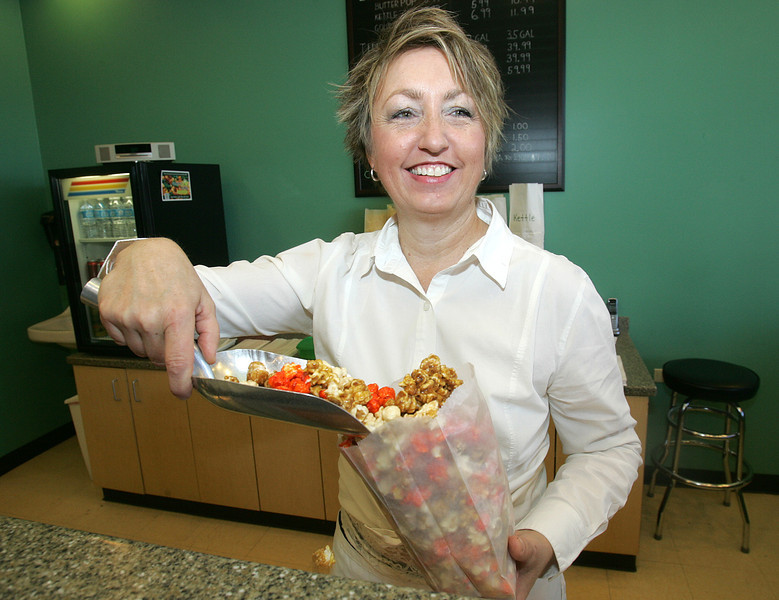 H. Rick Bamman - hbamman@shawmedia.com Judy Reyes owner of the Gourmet Kernel fills an order for Popfetti popcornat her shop in Algonquin Commons.