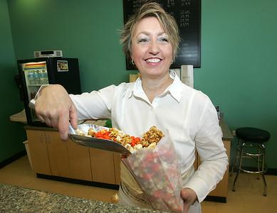 H. Rick Bamman - hbamman@shawmedia.com Judy Reyes owner of the Gourmet Kernel fills an order for Popfetti popcornat her shop in Algonquin Commons.