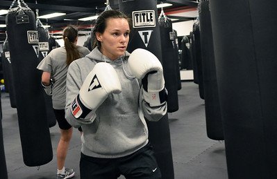 Monica Maschak - mmaschak@shawmedia.com Suzanne Leazzo, of Lake in the Hills, practices jabbing during a high-intensity cardio workout class that incorporates boxing techniques at Title Boxing Club in Crystal Lake on Tuesday, November 27, 2012.