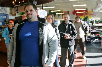 Monica Maschak - mmaschak@shawmedia.com Danny Walentin, of Cary, waits to buy a Powerball ticket as a line forms behind him at the Cary Thornton's on Wednesday, November 28, 2012.  Walentin said he would like to help Hurricane Sandy victims if he wins the $550 million jackpot.