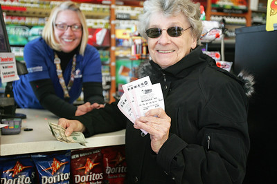 Monica Maschak - mmaschak@shawmedia.com Cary resident Betty Jankiewicz (right) holds up one Mega Millions and two Powerball tickets after purchasing them from the Thornton's gas station at the intersection of Three Oaks Road and Northwest Highway on Wednesday, November 28, 2012.  The sales of tickets for the $550 million Powerball jackpot have helped to more than double business at the Cary store said General Manager Pam Selemon (left).