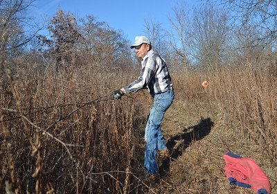 Monica Maschak - mmaschak@shawmedia.com President of the Richmond Trailblazers snowmobile club Dick Arseneau clears out brush from a snowmobile trail in Richmond on Wednesday, November 28, 2012.  The Richmond Trailblazers is one of ten clubs under the McHenry County Snowmobile Association.  Volunteers from the clubs prepare the trails to make them safe prior to for the opening on December 10, 2012.