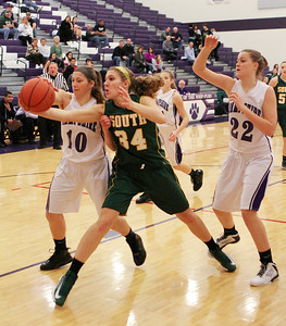 Mike Greene For the Northwest Herald Hampshire's Jenny Dumoulin (left) knocks the ball out of the hands of Crystal Lake South's Sara Mickow during the first quarter of a game Friday, November 30, 2012 in Hampshire. Crystal Lake South defeated Hampshire 46-41.