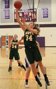 Mike Greene For the Northwest Herald Crystal Lake South's Sara Mickow puts up a shot during the first quarter of a game against Hampshire Friday, November 30, 2012 in Hampshire. Crystal Lake South defeated Hampshire 46-41.