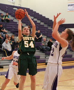 Mike Greene For the Northwest Herald Crystal Lake South's Chanel Fanter releases a shot as Hampshire's Emma Beniot defends during the frouth quarter of a game Friday, November 30, 2012 in Hampshire. Crystal Lake South defeated Hampshire 46-41.