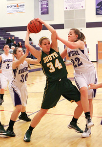 Mike Greene For the Northwest Herald Hampshire's Tricia Dumoulin (left) and Emma Benoit (right) defend Crystal Lake South's Sara Mickow during the first quarter of a game Friday, November 30, 2012 in Hampshire. Crystal Lake South defeated Hampshire 46-41.