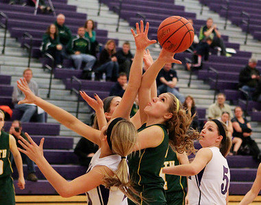 Mike Greene For the Northwest Herald Crystal Lake South's Sara Mickow goes up for a rebound while surrounded by a group of Hampshire defenders during the third quarter of a game Friday, November 30, 2012 in Hampshire. Crystal Lake South defeated Hampshire 46-41.