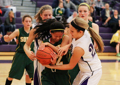 Mike Greene For the Northwest Herald Crystal Lake South's Gaby De Jesus (left) and Hampshire's Lizzy Panzica fight for possesion during the second quarter of a game Friday, November 30, 2012 in Hampshire. Crystal Lake South defeated Hampshire 46-41.