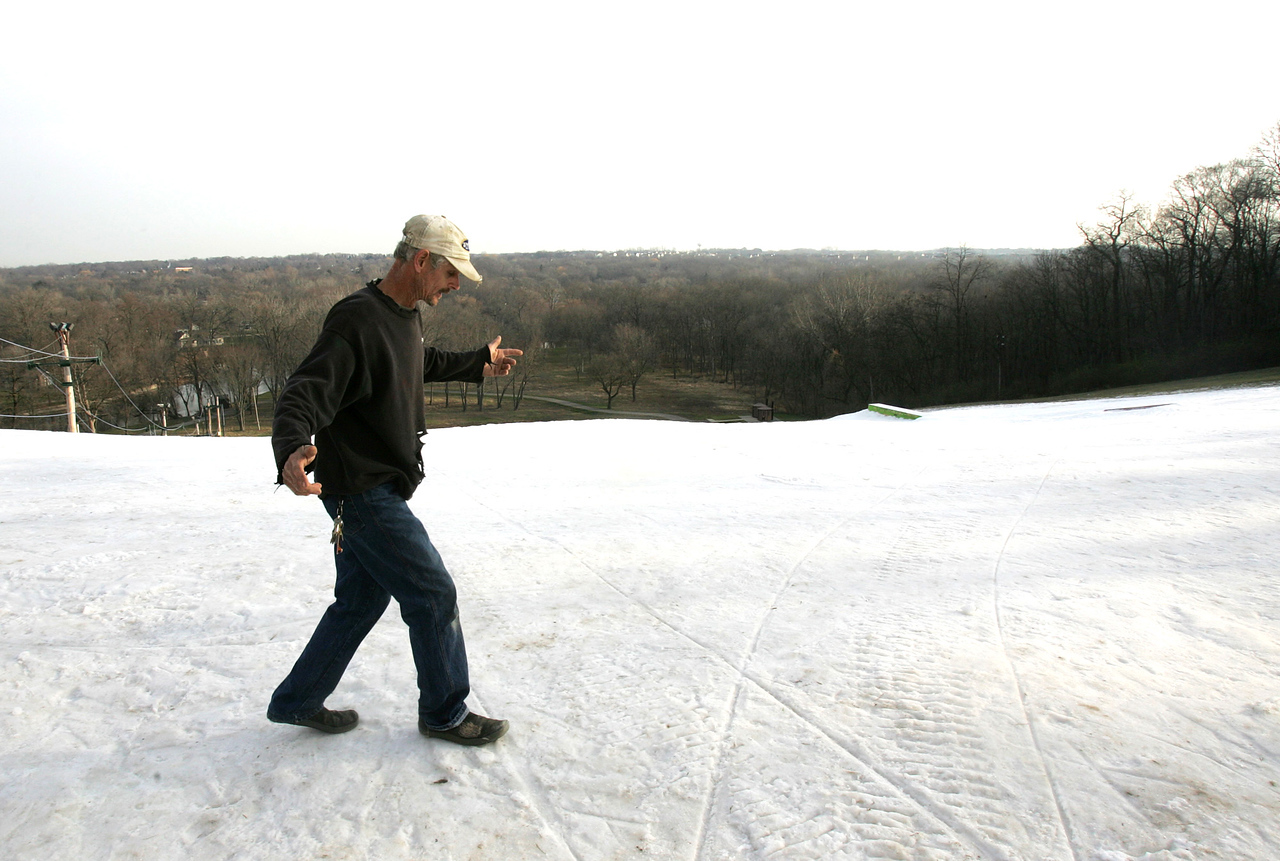 H. Rick Bamman - hbamman@shawmedia.com Raging Buffalo operations manager Kirk Muse checks the snow base of the main hill in Algonquin on Friday. Muse said that about 30 percent of the hill is open with snow making operations underway when weather permits.