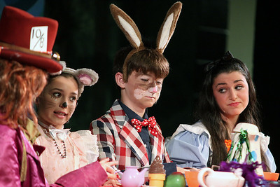 "Jeff Krage – For Shaw Media Alice (right), played by Sydney Bakal, acts out a scene with Dormouse (left), played by Emma Sullivan, and March Hare, played by Paddy Furlong, during Prairie Middle School's presentation of ""Alice in Wonderland"" on Friday.  Barrington 11/1/13"