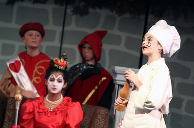 "Jeff Krage – For Shaw Media The Cook, played by Julia Stegvik, acts out a scene during Prairie Middle School's presentation of ""Alice in Wonderland"" on Friday.  Barrington 11/1/13"