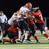Aurora Christian's Jonah Walker (65) Justin Brothers (44) Ryan Suttle (32) tackle Winnebago's Derek Polkowski (10) for a loss in the backfield at Aurora Christian in Aurora, IL on Saturday, November 10, 2012 (Sean King for The Kane County Chronicle)