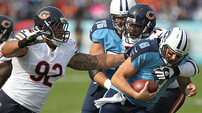 H. Rick Bamman - hbamman@shawmedia.com The Titans' Matt Hasselbeck is sacked by Israel Idonijie (right) and Stephen Paea late in the first quarter in Nashville Sunday November 4, 2012.
