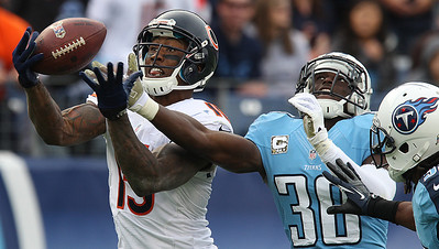 H. Rick Bamman - hbamman@shawmedia.com The Bears's Brandon Marshall snags a Jay Cutler pass past Titan defenders Jason Mcourty (30) and Michael Griffin (33) in the fourth quarter Sunday November 4, 2012 in Nashville.