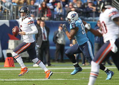 H. Rick Bamman - hbamman@shawmedia.com Bears Jay Cutler scampers away from the Titans' Derrick Morgan in the first quartrer Sunday November 4, 2012.
