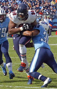 H. Rick Bamman - hbamman@shawmedia.com Bears' Corey Wootton grabs the Sherruck McManis blocked punt for a touchdown early in the first quartera gainst the Titans  Sunday November 4, 2012 in Nashville.