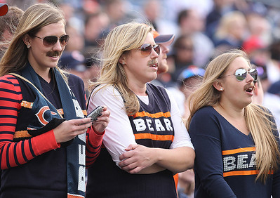 H. Rick Bamman - hbamman@shawmedia.com Bears' fans Resi Ertler, Rebecca Ash and Leeann Hupfer all of Chicago sport Ditka moustaches at the game with the Titans in Nashville Sunday November 4, 2012.