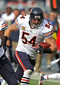 H. Rick Bamman - hbamman@shawmedia.com The Bears' Brian Urlacher returns his interception for a touchdown in the first quaerter against the Titans Sunday November 4, 2012 in Nashville.