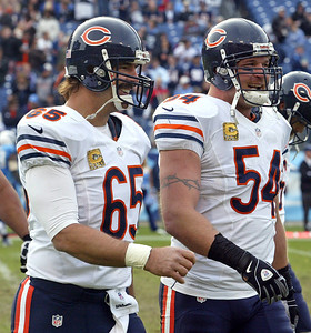 H. Rick Bamman - hbamman@shawmedia.com The Bears' Patrick Mannelly (left) and Brian Urlacher have wide smiles as they walk back to the sidlines Sunday November 4, 2012 in Nashville.