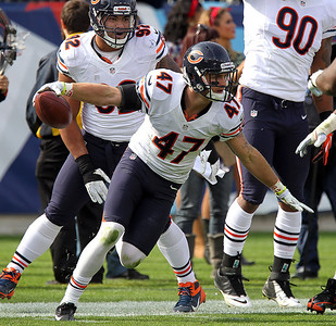 H. Rick Bamman - hbamman@shawmedia.com The Bears' Chris Conte celebrates as he recovers a fumble by the Titans'  Chris Johnson late in the first quarter Sunday November 4, 2012 in Nashville.