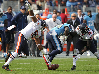 H. Rick Bamman - hbamman@shawmedia.com The Bears' Charles Tillman (right) forces the Titans' Chris Johnson to fumble as Lance Briggs comes into assisit in the first quarter Sunday November 4, 2012 in Nashville.