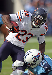 H. Rick Bamman - hbamman@shawmedia.com Tennessee Titans' Jamie Harper tackels the Bears' Devin Hester after a long punt return late in the first quarter Sunday November 4, 2012 in Nashville.