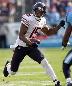 H. Rick Bamman - hbamman@shawmedia.com The Bears's Brandon Marshall runs for a first down after catching a Jay Cutler pass late in the first quarter against the Titans  Sunday November 4, 2012 in Nashville.