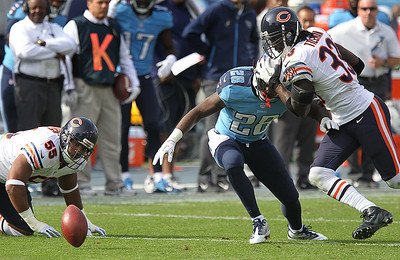 H. Rick Bamman - hbamman@shawmedia.com The Bears's Charles Tillman (right) prevents the Titansle Chris Johnson (28) from recovering his fumble while the ball bounces past Lance Briggs (left)  Sunday November 4, 2012 in Nashville,