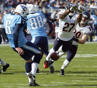 H. Rick Bamman - hbamman@shawmedia.com The Bears' Sherrick McManis blocks the Titan's Brett Kern's punt early in the first quarter in Nashville Sunday November 4, 2012.