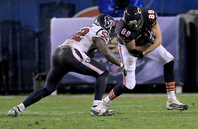 Sarah Nader - snader@shawmedia.com Houston's Tim Dobbins (left) guards Chicago's Matt Spaeth while be runs a play during the fourth quarter of Sunday's game  at Sholdier Field in Chicago on November, 11, 2012. The Chicago Bears were defeated, 6-13.