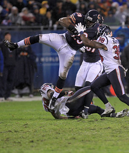 Sarah Nader - snader@shawmedia.com Chicago's Michael Bush (left) is tackled by Houston's Danieal Manning during the third quarter of Sunday's game  at Sholdier Field in Chicago on November, 11, 2012. The Chicago Bears were defeated, 6-13.