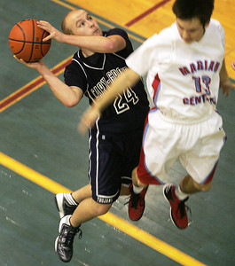Monica Maschak - mmaschak@shawmedia.com Cary-Grove Guard Michael Krich jumpes to shoot the ball over Marian Central's Matt Yuk during the Hoops for Healing basketball tournament at Woodstock High School on Friday, November 23, 2012. Cary-Grove won 62-53 in double overtime.