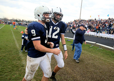 Sarah Nader - snader@shawmedia.com Cary-Grove's Quinn Baker (left) walks off the field after winning Saturday's 6A quarterfinal football game against Crystal Lake Central in Cary on November 10, 2012. Cary-Grove won, 7-0.