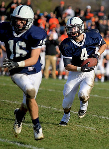 Sarah Nader - snader@shawmedia.com Cary-Grove's Ryan Mahoney (right) runs a play during the second quarter of Saturday's 6A quarterfinal football game against Crystal Lake Central in Cary on November 10, 2012. Cary-Grove won, 7-0.