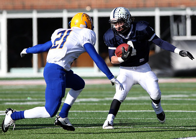 Josh Peckler - Jpeckler@shawmedia.com Cary-Grove's Ryan Mahoney runs the ball against Crete- Monee's Trevon Smith during the second quarter of the IHSA 6A State Championship game at Memorial Stadium in Champaign Saturday, November 24, 2012.