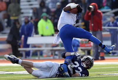 Josh Peckler - Jpeckler@shawmedia.com Cary-Grove's Kasey Fields tries to bring down Crete- Monee's Lance Lenoir during the second quarter of the IHSA 6A State Championship game at Memorial Stadium in Champaign Saturday, November 24, 2012.