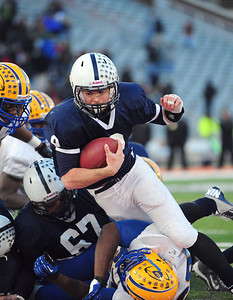 Josh Peckler - Jpeckler@shawmedia.com Cary-Grove quarterback Quinn Baker runs with the ball during the third quarter against Crete-Monee of the IHSA 6A State Championship game at Memorial Stadium in Champaign Saturday, November 24, 2012. Cary-Grove lost 26-33 to take home the second place trophy.