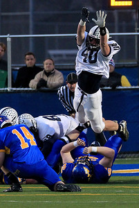 Sarah Nader - snader@shawmedia.com Cary-Grove's Brock Bussenger jumps to block a punt during Saturday's Class 6A semifinal game against Lake Forest on November 17, 2012 in Lake Forest. Cary-Grove won, 42-21.