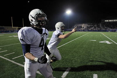 Sarah Nader - snader@shawmedia.com Cary-Grove's Ryan Mahoney (left) and Quinn Baker celebrate during the last seconds of Saturday's Class 6A semifinal game against Lake Forest on November 17, 2012 in Lake Forest. Cary-Grove won, 42-21.