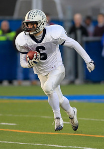 Sarah Nader - snader@shawmedia.com Cary-Grove's Marcus Thimios runs a play during Saturday's Class 6A semifinal game against Lake Forest on November 17, 2012 in Lake Forest. Cary-Grove won, 42-21.