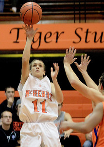 Sarah Nader - snader@shawmedia.com McHenry's Nick Bellich takes a shot during Monday's Coaches Vs. Cancer Thanksgiving Tournament against Hoffman Estates at Crystal Lake Central on November 19, 2012. McHenry was defeated, 52-62.