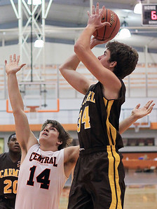 Sarah Nader - snader@shawmedia.com Crystal Lake Central's DJ Thomas (left) guards Carmel's Cullen Barr during the first quarter Monday's Coaches Vs. Cancer Thanksgiving Tournament at Crystal Lake Central on November 19, 2012.